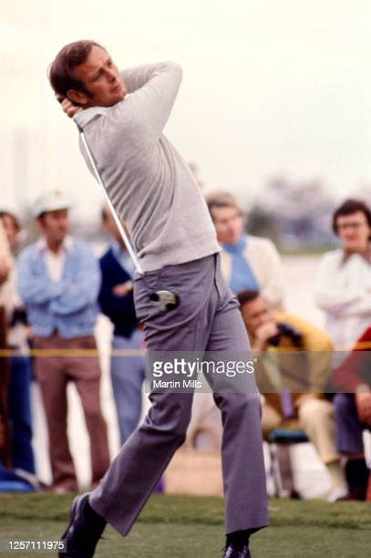 Golfer Bruce Devlin of Australia hits his shot during the Jackie Gleason Inverrary-National Airlines Classic on February 22, 1973 at the PGA National...