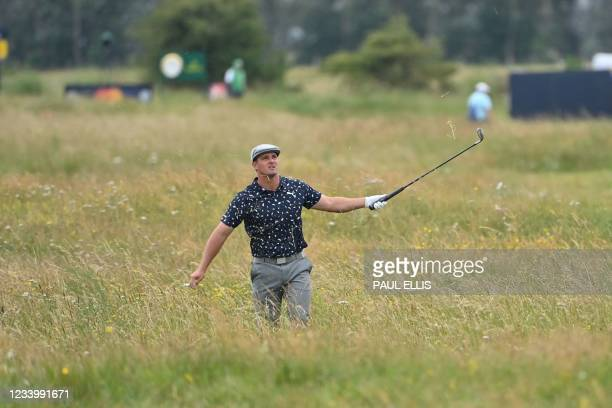 Golfer Bryson DeChambeau gestures from the deep rough on the 15th hole during his first round on day one of The 149th British Open Golf Championship...