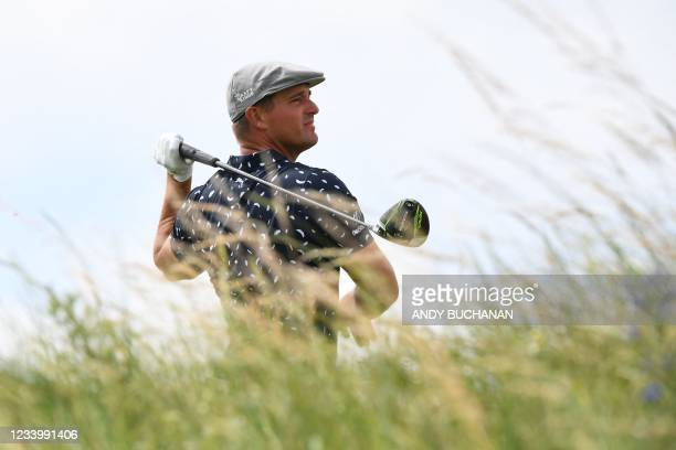 Golfer Bryson DeChambeau watches his drive from the 9th tee during his first round on day one of The 149th British Open Golf Championship at Royal St...