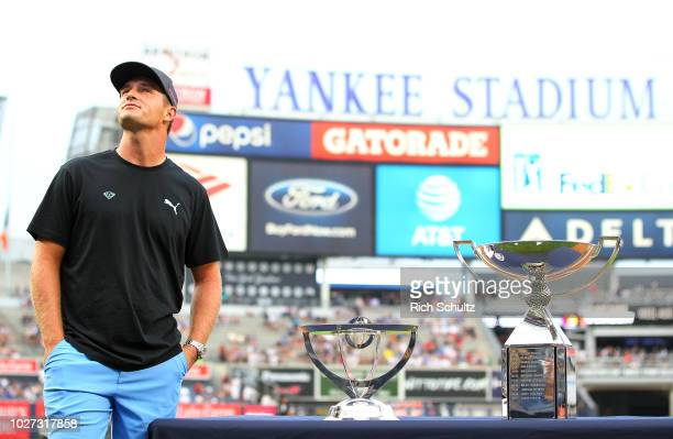 Golfer Bryson DeChambeau winner of the 2018 Northern Trust stands on the field before throwing out the first pitch before a baseball game between the...
