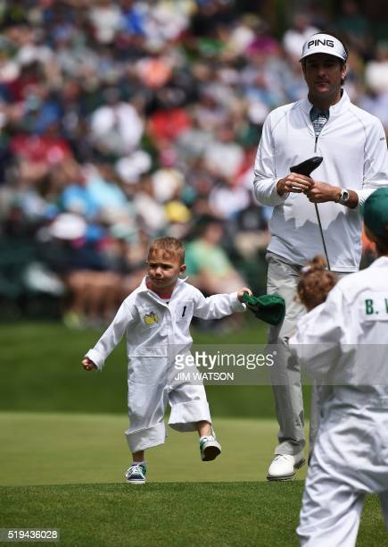 US golfer Bubba Watson and his son Caleb on the 8th green during the Par 3 contest prior to the start of the 80th Masters of Tournament at the...