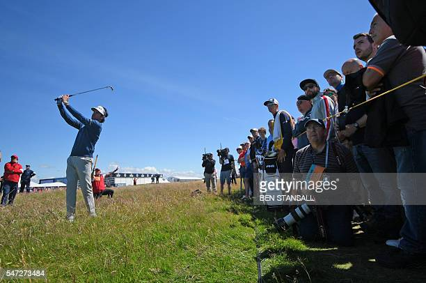 US golfer Bubba Watson plays from the rough on the 16th hole during his first round on the opening day of the 2016 British Open Golf Championship at...