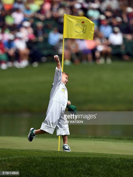 US golfer Bubba Watson's son Caleb plays on the 8th green during the Par 3 contest prior to the start of the 80th Masters of Tournament at the...