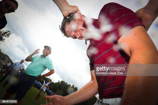 Golfer Cameron Smith of Australia is sprayed with champagne following his victory in the Australian PGA Championship golf tournament at the Royal...