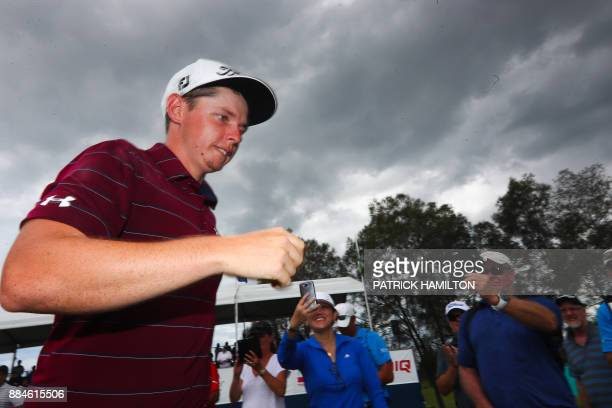 Golfer Cameron Smith of Australia leaves the 18th green following his victory in the Australian PGA Championship golf tournament at the Royal Pines...