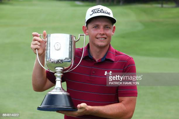 Golfer Cameron Smith of Australia poses with the Kirkwood Cup following his victory in the Australian PGA Championship golf tournament at the Royal...
