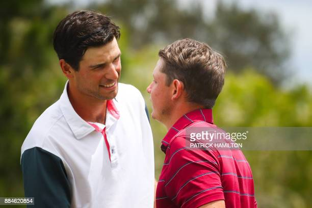 Golfer Cameron Smith of Australia speaks with Jordan Zunic of Australia during a playoff after the final round of the Australian PGA Championship...