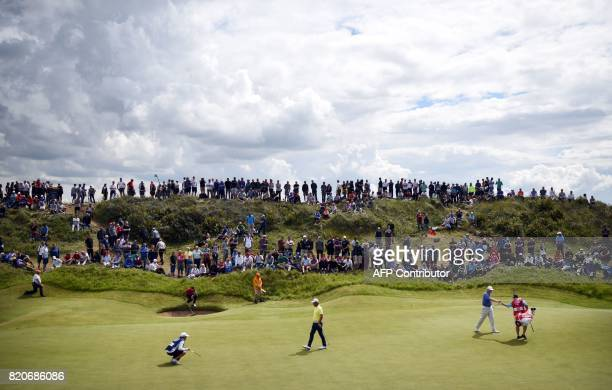 TOPSHOT US golfer Chan Kim in yellow and South Africa's Ernie Els on the 2nd green during their third rounds on day three of the Open Golf...
