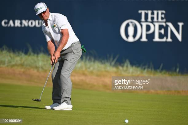 Golfer Charley Hoffman putts on the 18th green during his first round on day one of The 147th Open golf Championship at Carnoustie, Scotland on July...