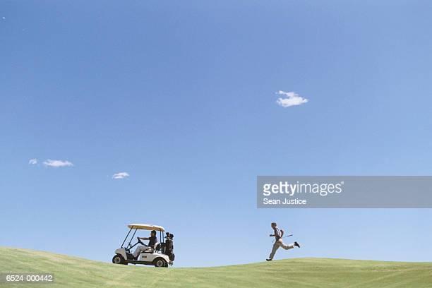 Golfer Chasing Golf Cart