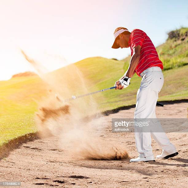 Golfer chipping the ball from sand trap