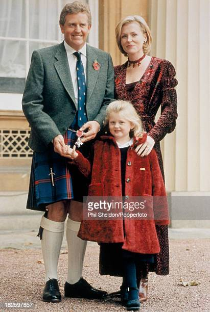 Golfer Colin Montgomerie of Great Britain with his wife Eimear and daughter Olivia after receiving an MBE from the Queen at Buckingham Palace London...
