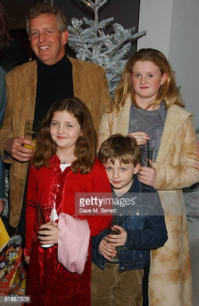 Golfer Colin Montgomery poses with his family at the Nutcracker Ballet gala preparty at St Martins Lane Hotel December 21 London