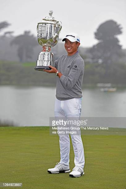 Golfer Collin Morikawa raises the Wanamaker Trophy during the trophy ceremony after the final round of the 102nd PGA Championship at TPC Harding Park...