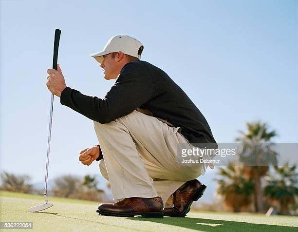 Golfer crouching