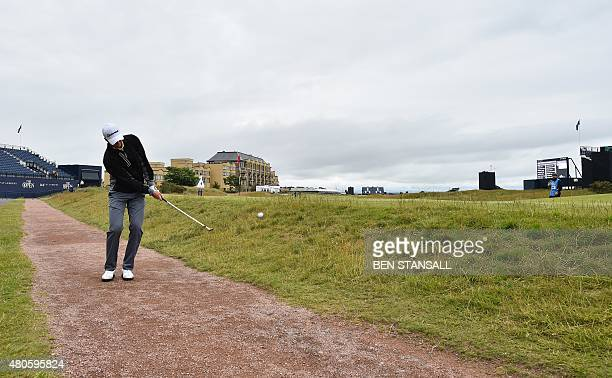 Golfer Daniel Berger chips onto the 17th green during a practice round on The Old Course at St Andrews in Scotland, on July 13 ahead of The 2015 Open...