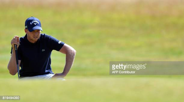 Golfer Daniel Berger lines up a putt on the 4th green during his opening round on the first day of the Open Golf Championship at Royal Birkdale golf...