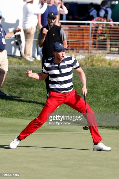Golfer Daniel Berger reacts to making a birdie putt on the 14th hole during the final round of the Presidents Cup at Liberty National Golf Club on...