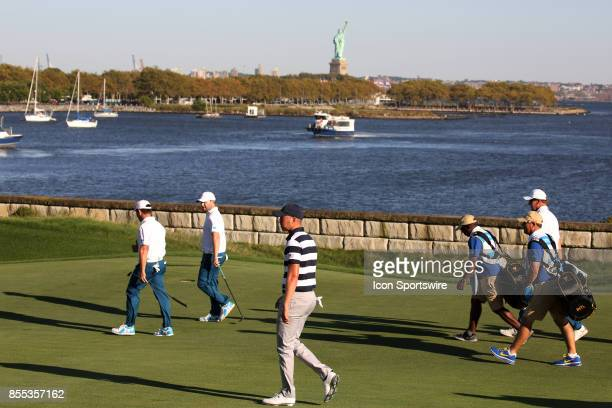 Golfer Daniel Berger walks the 14th hole with the Statue of Liberty in the background during the first round of the Presidents Cup on September 28 at...