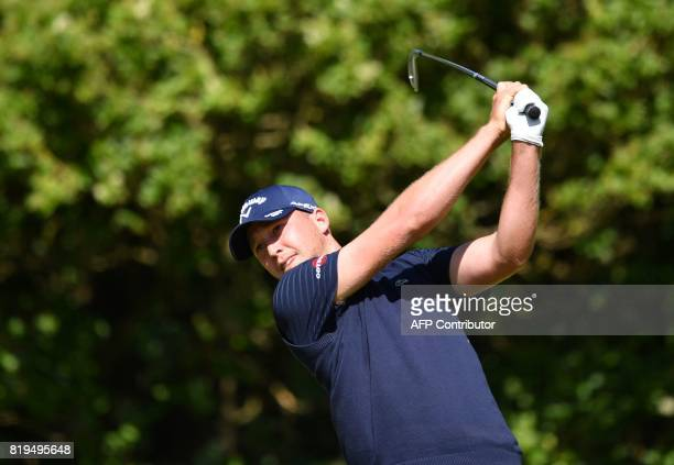 Golfer Daniel Berger watches his shot from the 5th tee during his opening round on the first day of the Open Golf Championship at Royal Birkdale golf...