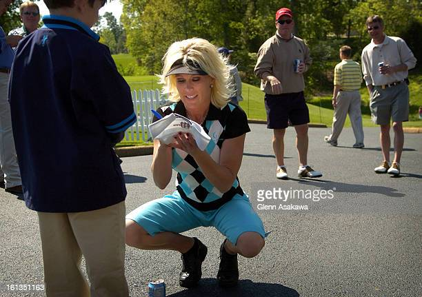 WILLIAMSBURG VAMAY 4 2005LPGA golfer Danielle <cq> Amiee <cq> signs an autograph for a young fan during the LPGA Michelob Ultra Open at Kingsmill in...