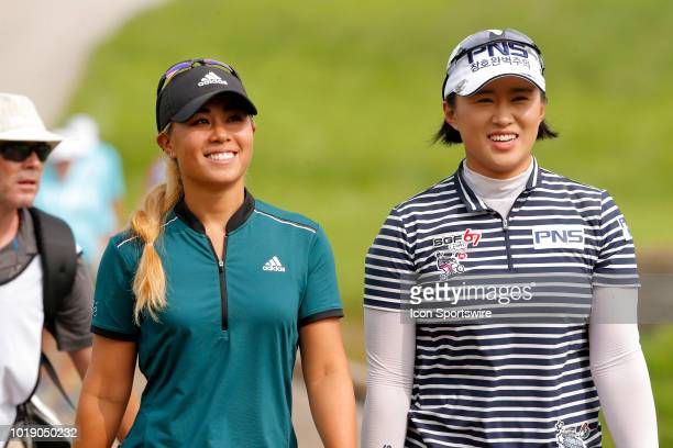 LPGA golfer Danielle Kang and LPGA golfer golfer Amy Yang walk to the ninth tee box during the third round of the Indy Women In Tech on August 18...