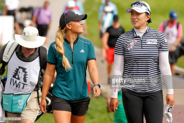 LPGA golfer Danielle Kang and LPGA golfer golfer Amy Yang walk to the ninth tee during the third round of the Indy Women In Tech on August 18 2018 at...