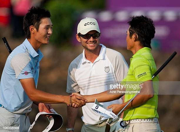 Golfer Danny Lee of New Zealand shakes hand with Golfer Ryuji Imada of Japan as Hollywood actor Christian Slater of USA smile during day four of the...