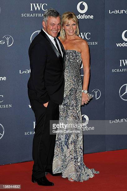 Golfer Darren Clarke and guest attend the 2012 Laureus World Sports Awards at Central Hall Westminster on February 6 2012 in London England