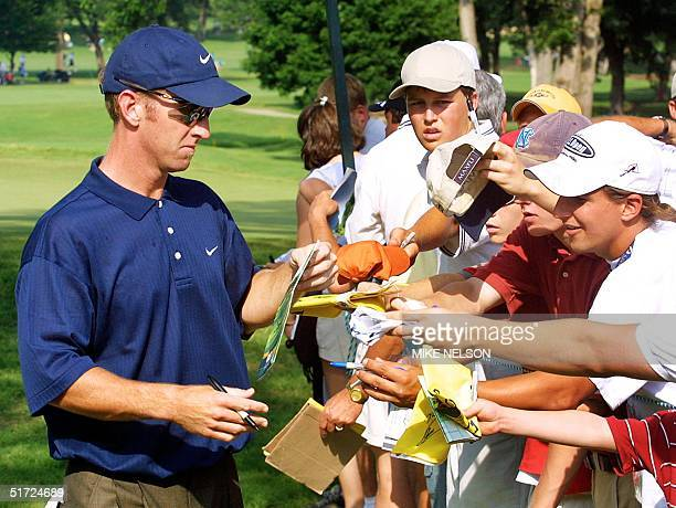 Golfer David Duval signs autographs for fans during a practice round before the start of the 2001 US Open Championship at the Southern Hill Country...