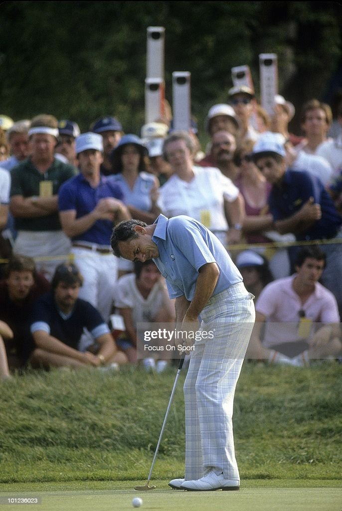 Golfer David Graham of Australia putts and watches his ball roll towards the hole June 21, 1981 during the US Open Golf tournament at Merion Golf Club in Admore Pennsylvania. Graham won the tournament by three strokes at -7 under par.