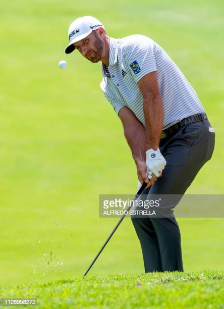 US golfer Dustin Johnson aims at the hole of the 1st green during the third round of the PGA World Golf Championship at Chapultepec's Golf Club in...