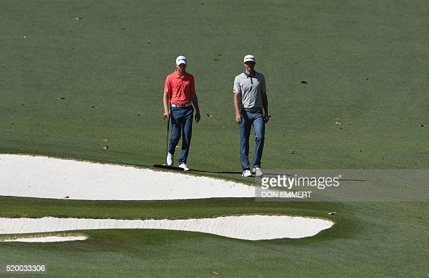 Golfer Dustin Johnson and US golfer Daniel Berger walk on the 10th fairway during Round 3 of the 80th Masters Golf Tournament at the Augusta National...