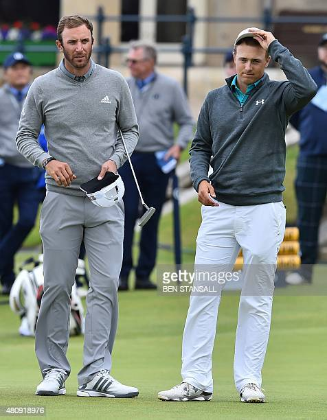 US golfer Dustin Johnson and US golfer Jordan Spieth wait on the 18th green during their first rounds on the opening day of the 2015 British Open...