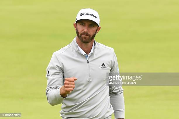 US golfer Dustin Johnson celebrates a putt at the 18th hole during the second round of the British Open golf Championships at Royal Portrush golf...