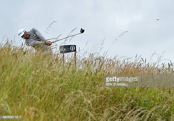 US golfer Dustin Johnson drives from the 6th tee during his first round on the opening day of the 2015 British Open Golf Championship on The Old...