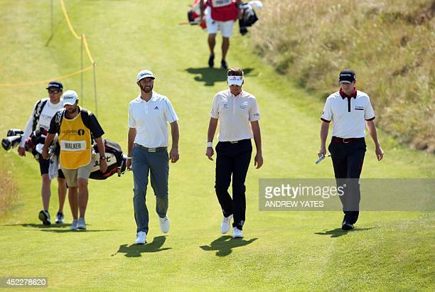 US golfer Dustin Johnson England's Ian Poulter and US golfer Jimmy Walker walk to the 13th tee during their first rounds on the opening day of the...