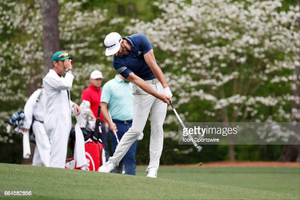 PGA golfer Dustin Johnson hits a shot from the 10th fairway during the first day of practice for the 2017 Masters Tournament on April 3 at Augusta...