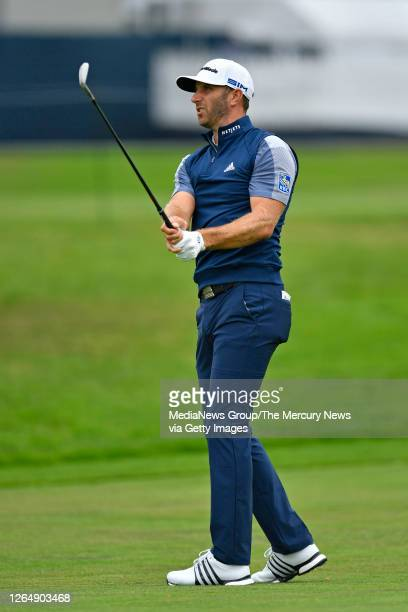 Golfer Dustin Johnson hits from the fairway on the first hole during the final round of the 102nd PGA Championship at TPC Harding Park in San...