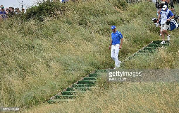 US golfer Dustin Johnson leaves the tee during his fourth round on the final day of the 2014 British Open Golf Championship at Royal Liverpool Golf...