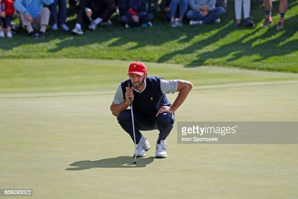 USA golfer Dustin Johnson lines up a putt on the 14th hole during the third round of the Presidents Cup at Liberty National Golf Club on September 30...
