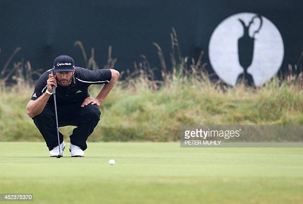 US golfer Dustin Johnson lines up a putt on the 3rd green during his third round on day three of the 2014 British Open Golf Championship at Royal...
