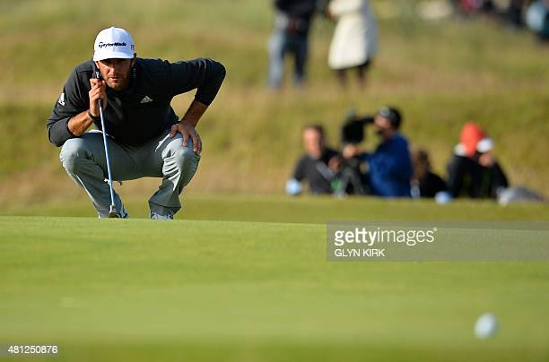 US golfer Dustin Johnson lines up his putt on the 17th green during the completion of his second round 69 on day three of the 2015 British Open Golf...