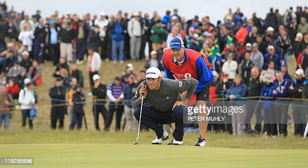 US golfer Dustin Johnson lines up his putt on the 5th green on the final day of the 140th British Open Golf championship at Royal St George's in...