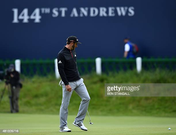 US golfer Dustin Johnson looks at his ball on the 18th green during his third round 75 on day four of the 2015 British Open Golf Championship on The...