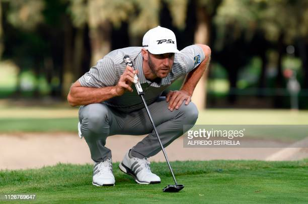 US golfer Dustin Johnson plans his shot on the 15th green during the second round of the PGA World Golf Championship at Chapultepec's Golf Club in...