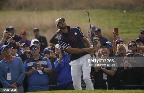 Golfer Dustin Johnson plays a chip shot on the first day of the 42nd Ryder Cup at Le Golf National Course at Saint-Quentin-en-Yvelines, south-west of...