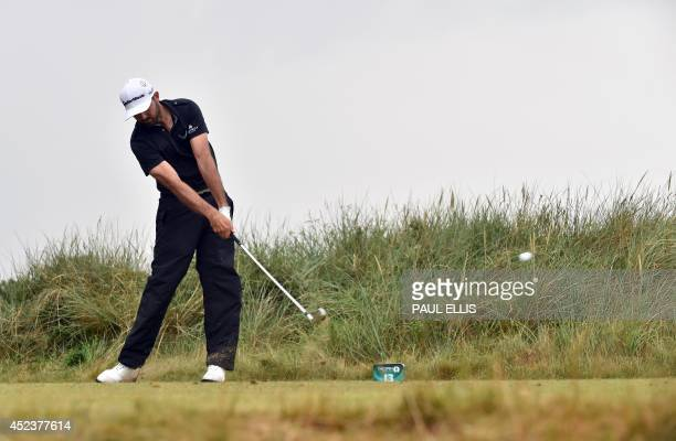 US golfer Dustin Johnson plays from the 13th tee during his third round on day three of the 2014 British Open Golf Championship at Royal Liverpool...