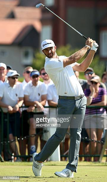 US golfer Dustin Johnson plays from the 3rd tee during his first round on the opening day of the 2014 British Open Golf Championship at Royal...