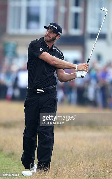 US golfer Dustin Johnson plays his approach shot to the 3rd green during his third round on day three of the 2014 British Open Golf Championship at...